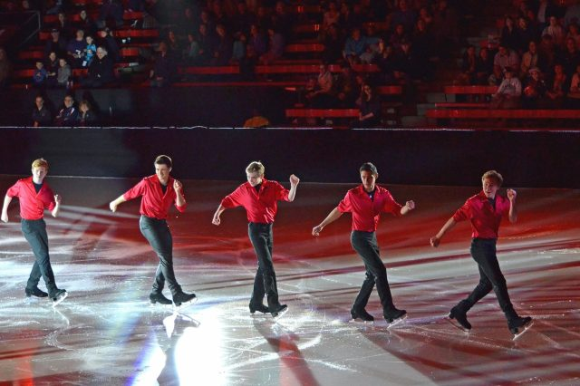 The men of the Skating Club of Boston perform a group number