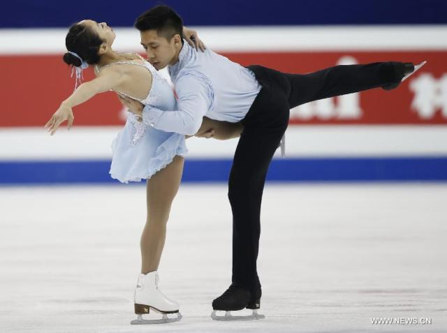 "Sui/Han:  ""Very interesting positions in the spins, different positions.""  (Xinhua/Wang Lili)"